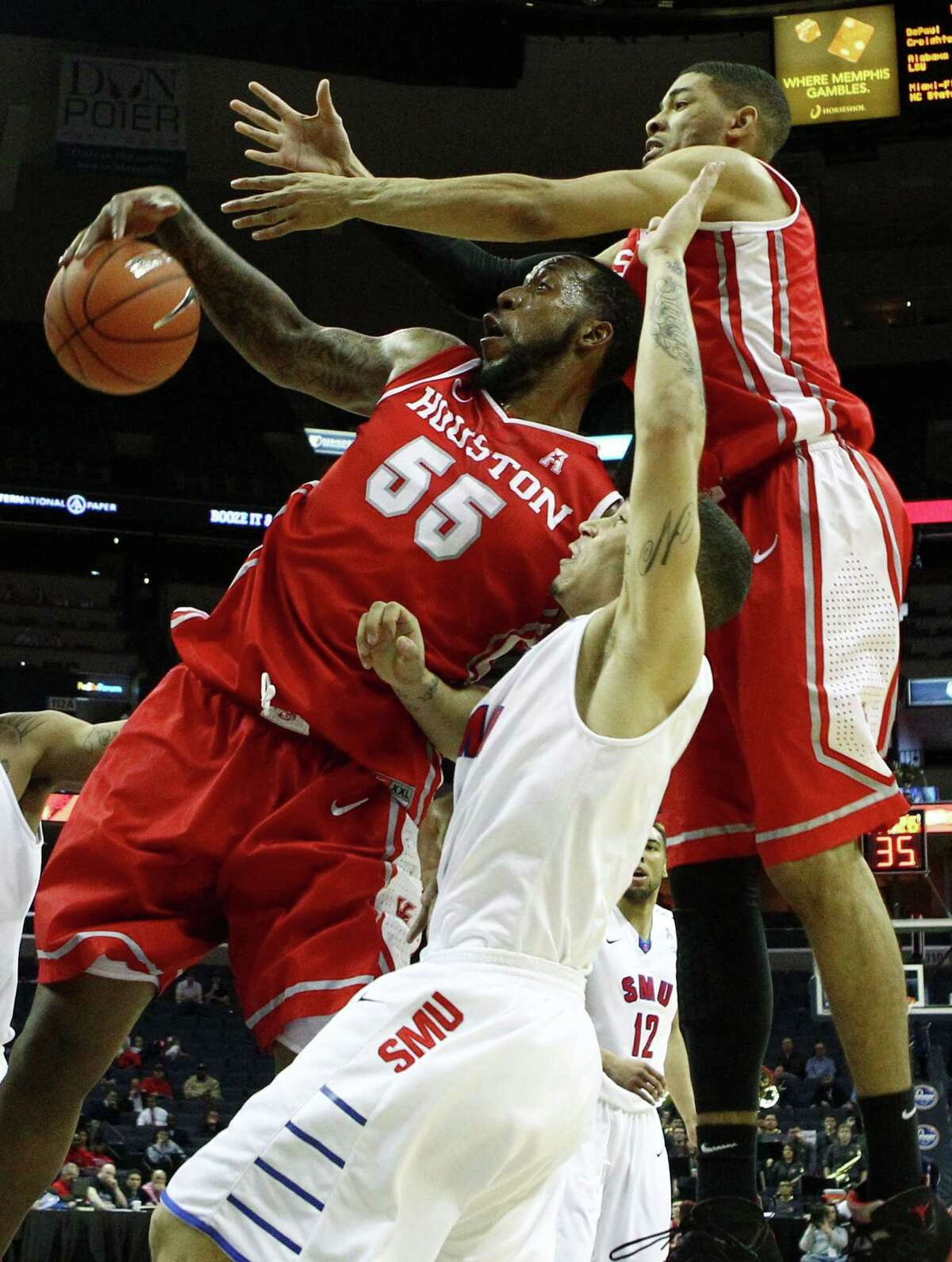 Houston Cougars forward J.J. Richardson (left), SMU Mustangs guard Nic Moore (center) and Houston Cougars guard LeRon Barnes (right) battle for a rebound during the quaterfinals of the American Athletic Conference tournament at FedExForum, March 13, 2014 in Memphis, Tenn. (Mike Brown/The Commercial Appeal/MCT)