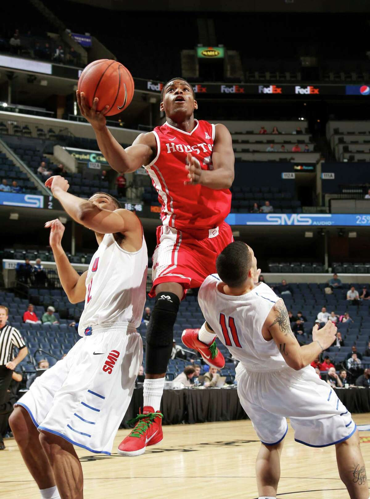 MEMPHIS, TN - MARCH 13: Danuel House #23 of the Houston Cougars drives to the basket against Nic Moore #11 of the SMU Mustangs during the quarterfinal round of the American Athletic Conference Tournament at FedExForum on March 13, 2014 in Memphis, Tennessee.