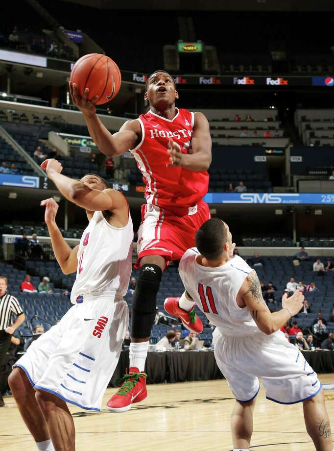 MEMPHIS, TN - MARCH 13: Danuel House #23 of the Houston Cougars drives to the basket against Nic Moore #11 of the SMU Mustangs during the quarterfinal round of the American Athletic Conference Tournament at FedExForum on March 13, 2014 in Memphis, Tennessee. Photo: Joe Murphy, Getty Images / 2014 Joe Murphy