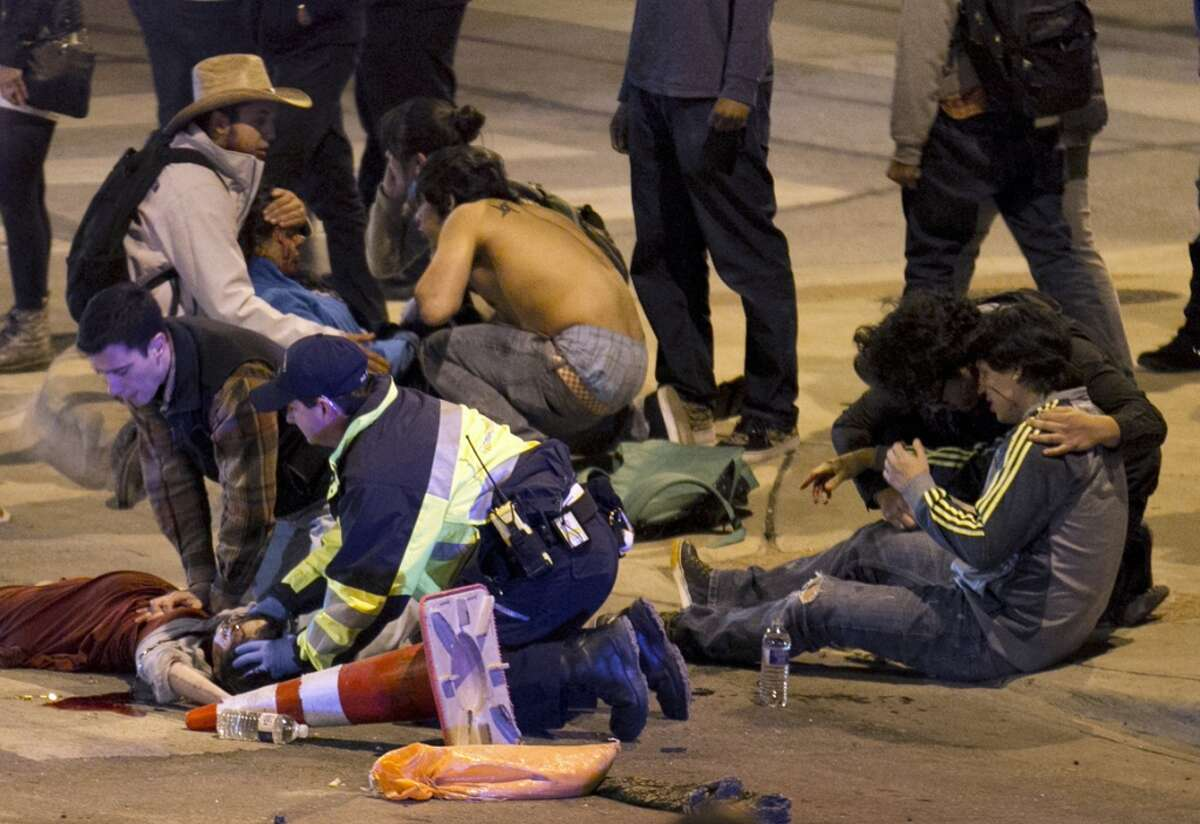 South by Southwest Festival 2014(March 13, 2014 - Austin, Texas) : Two people are killed and many others injured when an alleged drunk driver swerves into a crowd outside one of Austin's many music venues. (Jay Janner/Austin American-Statesman)