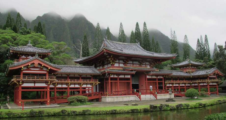 The Byodo-In Temple on Oahu's east, or windward, coast is a replica of a Japanese Buddhist temple. It sits within a sprawling cemetery called Valley of the Temples Memorial Park in Hawaii. (Kristin Jackson/Seattle Times/MCT) ORG XMIT: 1149706 Photo: KRISTIN JACKSON / Seattle Times