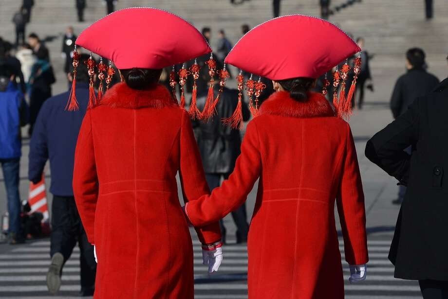 And the best hat award goes to ... Ethnic minority delegates walk to   the hall before the closing ceremony of the Chinese National People's Congress at the   Great Hall of the People in Beijing. Photo: Goa Chai Hin, AFP/Getty Images
