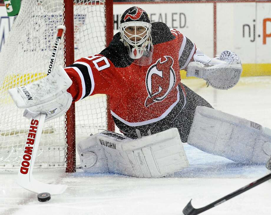 Martin Brodeur, the NHL's career leader in wins for goaltenders, has won his last four starts to help the Devils get within two points of the final playoff spot in the Eastern Conference. Photo: Bill Kostroun, Associated Press
