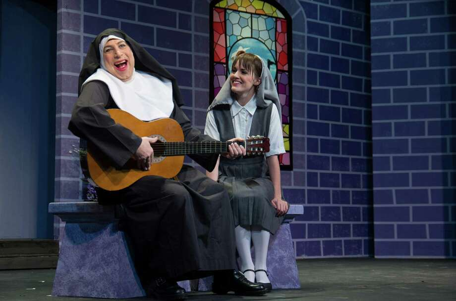 "Mother Superior (Kevin McDonough) sings with Agnes (Melanie Romano) in ""The Divine Sister"" by Charles Busch. This comic homage to nearly every Hollywood film involving nuns is on stage now through March 22 at Brookfield Theatre. Photo: Contributed Photo / The News-Times Contributed"