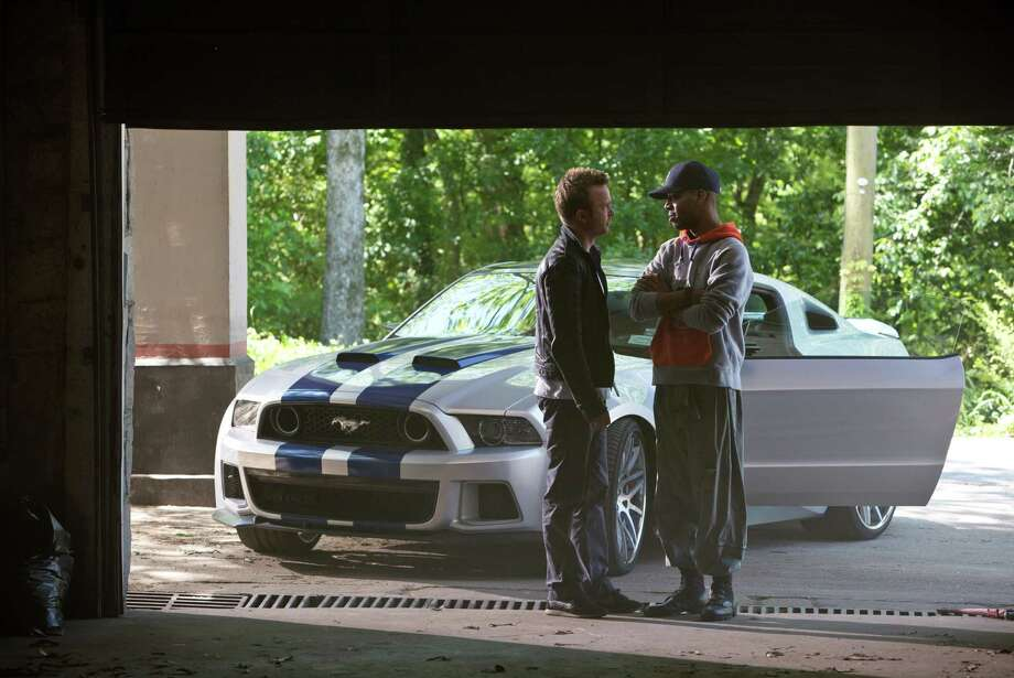 "This image released by DreamWorks II shows Aaron Paul, left, and Scott Mescudi in a scene from ""Need for Speed."" (AP Photo/DreamWorks II, Melinda Sue Gordon) ORG XMIT: NYET564 Photo: Melinda Sue Gordon / DreamWorks II"