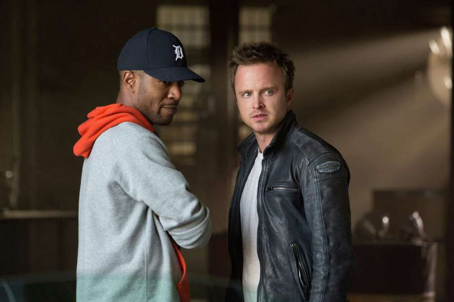 "This image released by DreamWorks II shows Scott Mescudi, left, and Aaron Paul in a scene from ""'Need for Speed.'"" Photo: Melinda Sue Gordon / DreamWorks II"