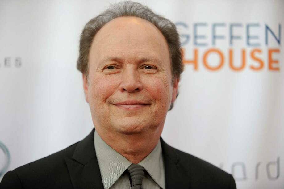 "FILE - This May 13, 2013 file photo shows actor Billy Crystal at the annual ""Backstage At The Geffen"" event at the Geffen Playhouse in Los Angeles. The star of ""City Slickers"" and ""When Harry Met Sally"" said Tuesday, May 14,  he will reprise his funny and poignant one-man autobiographical show A'A""700 SundaysA'A"" on Broadway for a 9-week stand this fall. (Photo by Richard Shotwell/Invision/AP, file) Photo: Richard Shotwell / Invision"
