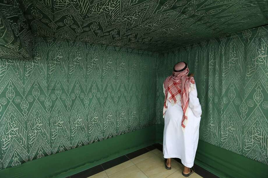 A visitor examines the internal Kiswa, a silk cloth that will cover the Holy Kaaba,  Islam's holiest site, from inside, at a factory in the holy city of Mecca. Photo: Mohamed Al Hwaity, Reuters
