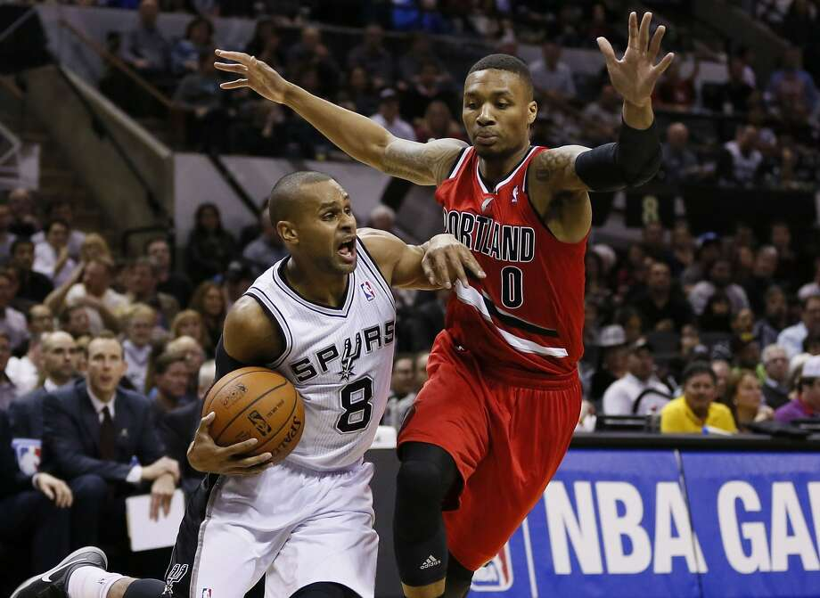 Mar 12, 2014; San Antonio, TX, USA; San Antonio Spurs guard Patrick Mills (8) drives to the basket as Portland Trail Blazers guard Damian Lillard (0) defends during the first half at AT&T Center. Mandatory Credit: Soobum Im-USA TODAY Sports Photo: Soobum Im, Reuters