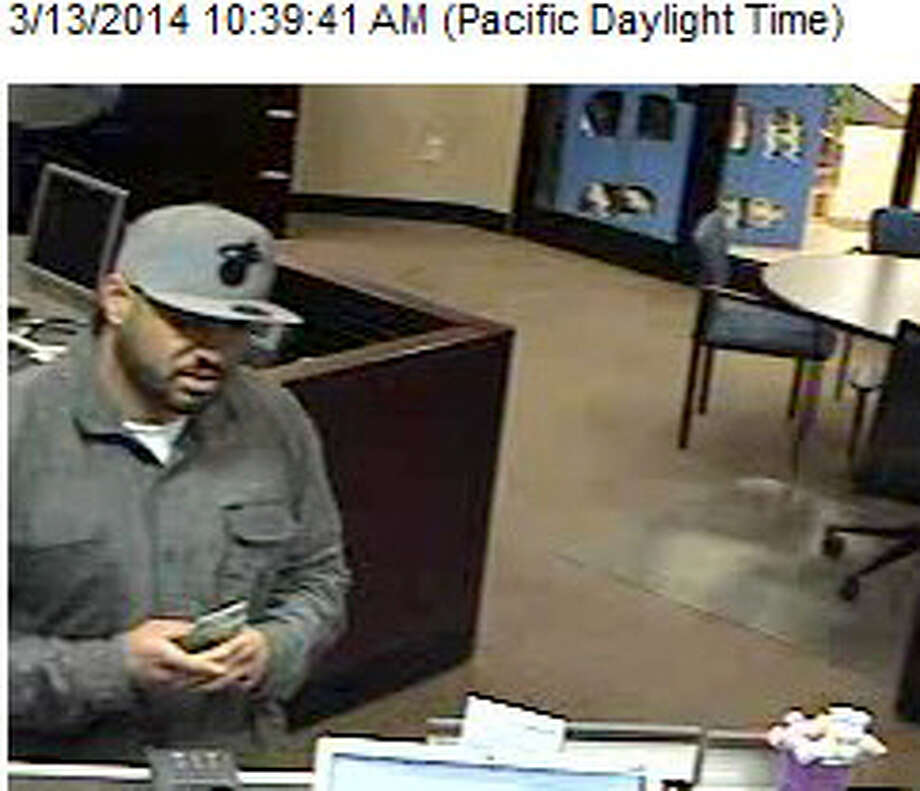 This image captures an alleged bank robber who hit the Chase Bank inside the Covington Fred Meyer Thursday morning. King County Sheriff's detectives seek the public's help in finding him. Photo: King County Sheriff's Office