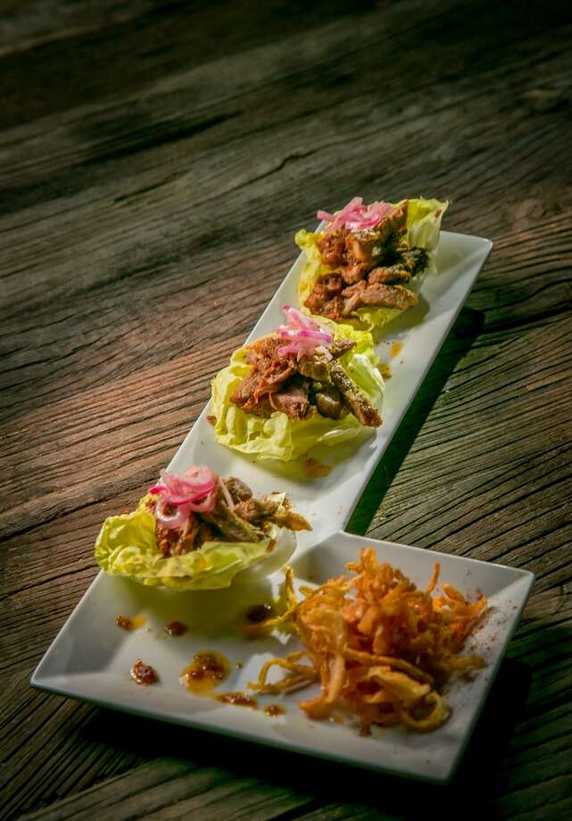 The Indo-Cajun Pork Tenderloin lettuce cups at Kanishka's Neo-Indian Gastropub in Walnut Creek, Calif., are seen on Wednesday, February 26th, 2014. Photo: Special To The Chronicle