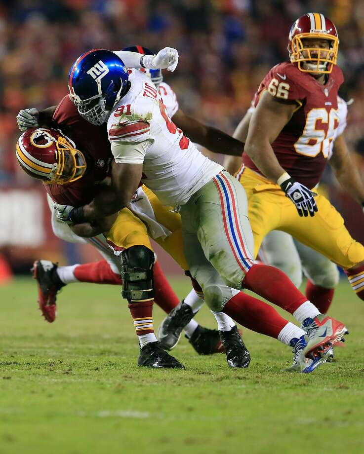 Defensive end Justin Tuck had 11 sacks for the Giants last season and 60.5 in nine NFL seasons. Photo: Rob Carr, Getty Images