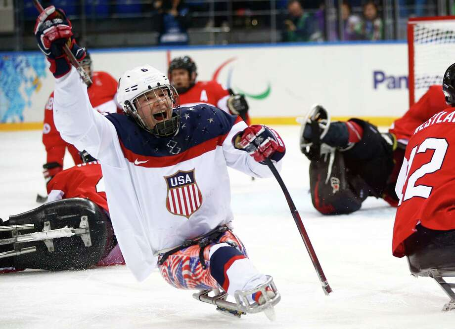 United States' Declan Farmer celebrates his goal during the ice sledge hockey semifinal match against Canada at the 2014 Winter Paralympics in Sochi the 2014 Winter Paralympics in Sochi, Russia, Thursday, March 13, 2014. United States won 3-0. (AP Photo/Pavel Golovkin) Photo: Pavel Golovkin, Associated Press / AP