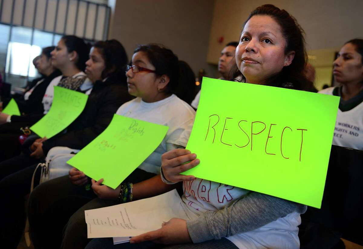 Mariana Reyes, of Bridgeport, attends a public hearing Thursday, Mar. 13, 2014, in support of the proposed Connecticut Domestic Workers' Bill of Rights at City Hall in Bridgeport, Conn.