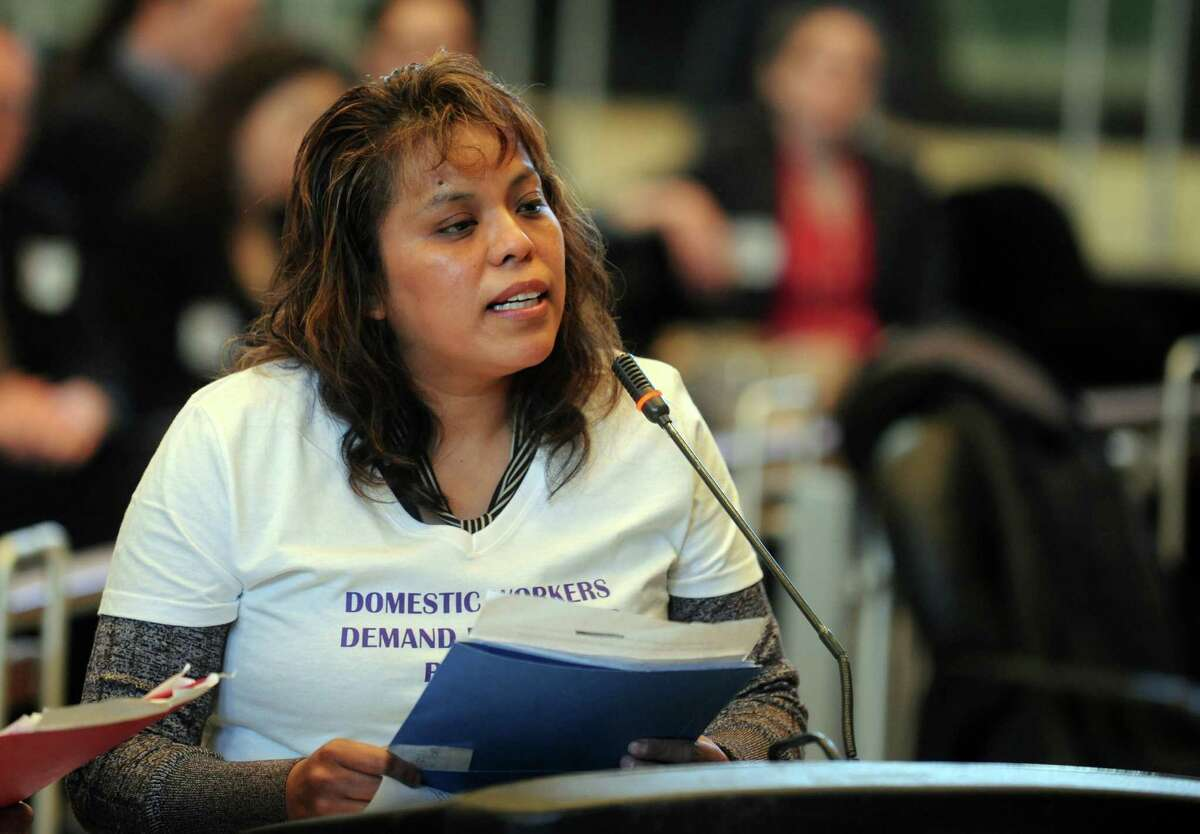Petra Morales, of Bridgeport, testifies during a public hearing Thursday, Mar. 13, 2014, in support of the proposed Connecticut Domestic Workers' Bill of Rights at City Hall in Bridgeport, Conn.