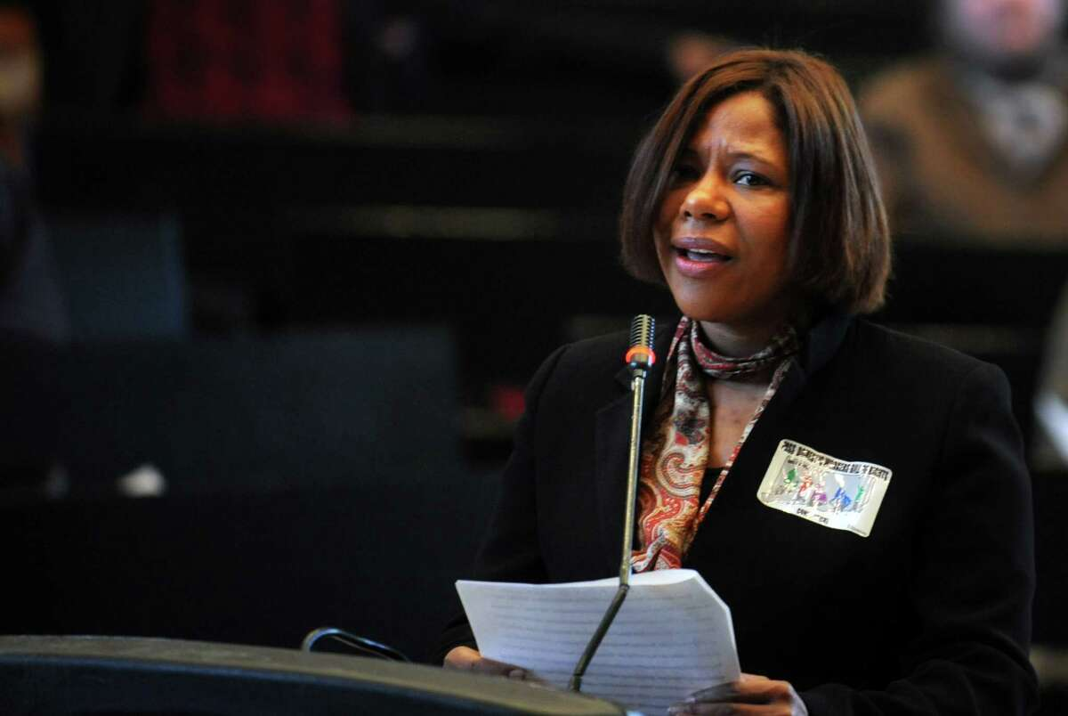 Natalicia Tracy, executive director of the Brazilian Immigrant Center in Boston, Mass., and a former domestic worker, testifies during a public hearing Thursday, Mar. 13, 2014, in support of the proposed Connecticut Domestic Workers' Bill of Rights at City Hall in Bridgeport, Conn.