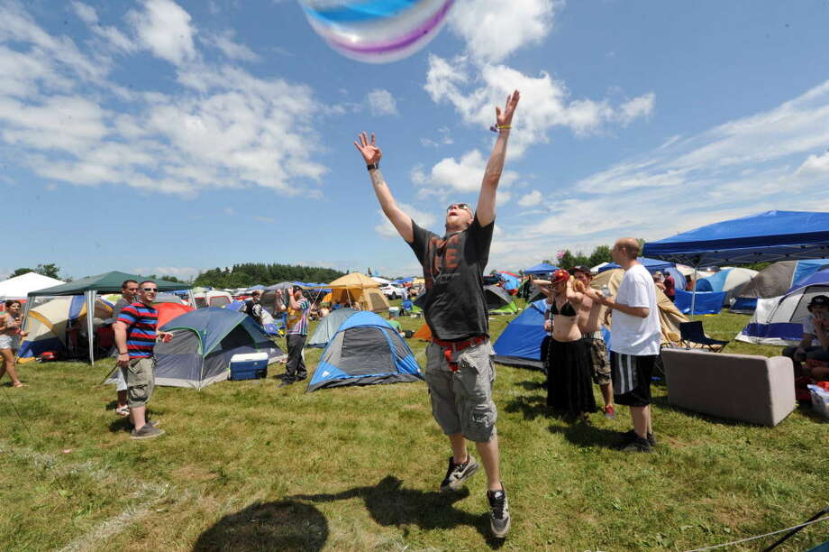 Aaron Glatfelter of Pennsylvania plays with a large beach ball in the camping area during Camp Bisco on Thursday July 11, 2013 in Mariaville, N.Y. Concert organizers are skipping this year's version.  (Michael P. Farrell/Times Union)
