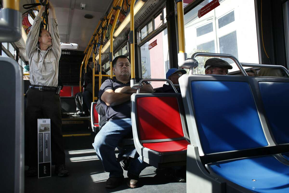 Muni bus driver Wah Li stretches as he rides as a passenger across town on the 27 Bryant bus, Thursday March 13, 2014, in San Francisco, Calif. The Transit Effectiveness Plan program which aims to adjust and redesign its bus routes for the first time in 30 years, which could cause some harsh feeling due to the fact that people don't like change.