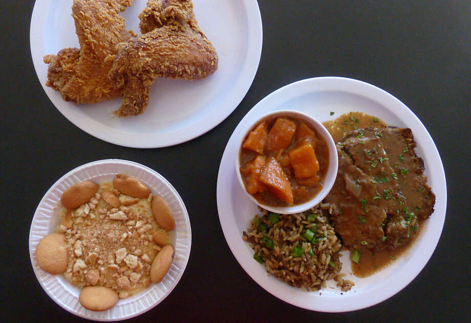 A tasty assortment: fried chicken wings; Kajun Plate with meatloaf, sweet potatoes and dirty rice; and banana pudding. Photo: Billy Calzada / San Antonio Express-News / San Antonio Express-News