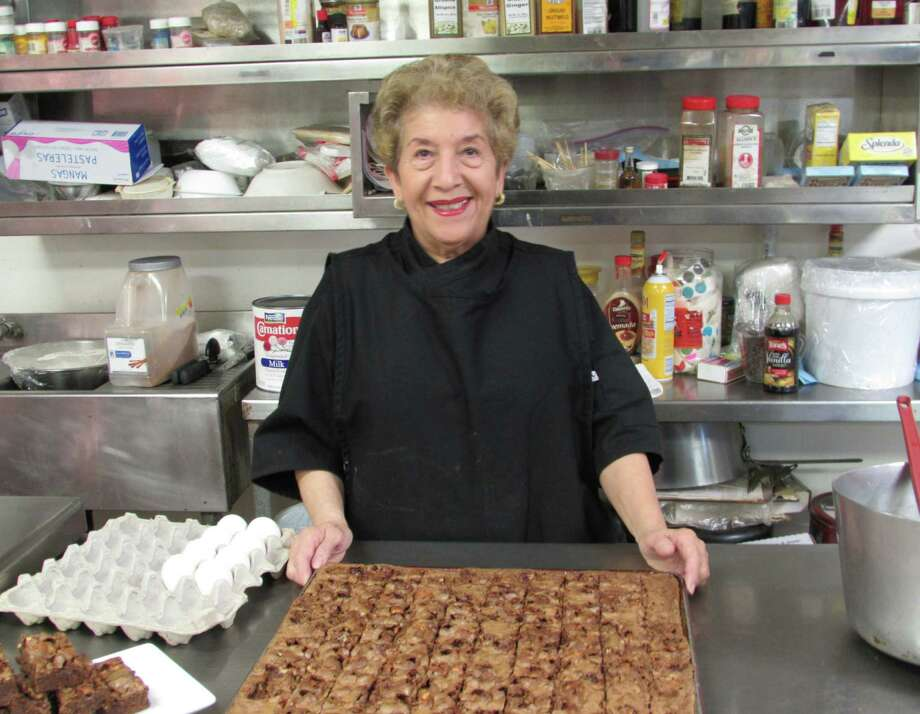 Maria Treviño has been baking brownies for Don Strange of Texas for more than 28 years. Photo: Burt Henry / San Antonio Express-News