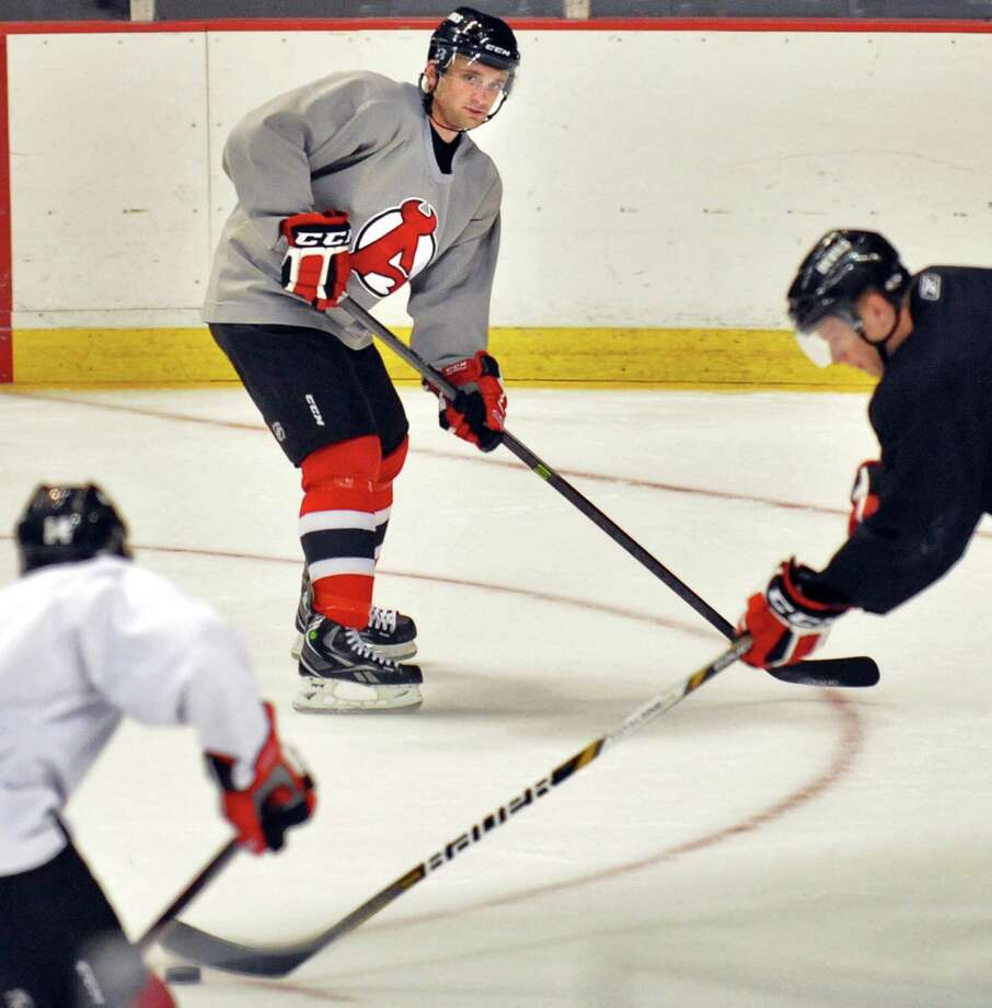 Albany Devils'  Tim Sestito, top,  during practice at the Times Union Center Thursday Oct. 3, 2013, in Albany, NY.(John Carl D'Annibale / Times Union) Photo: John Carl D'Annibale / 00024096A