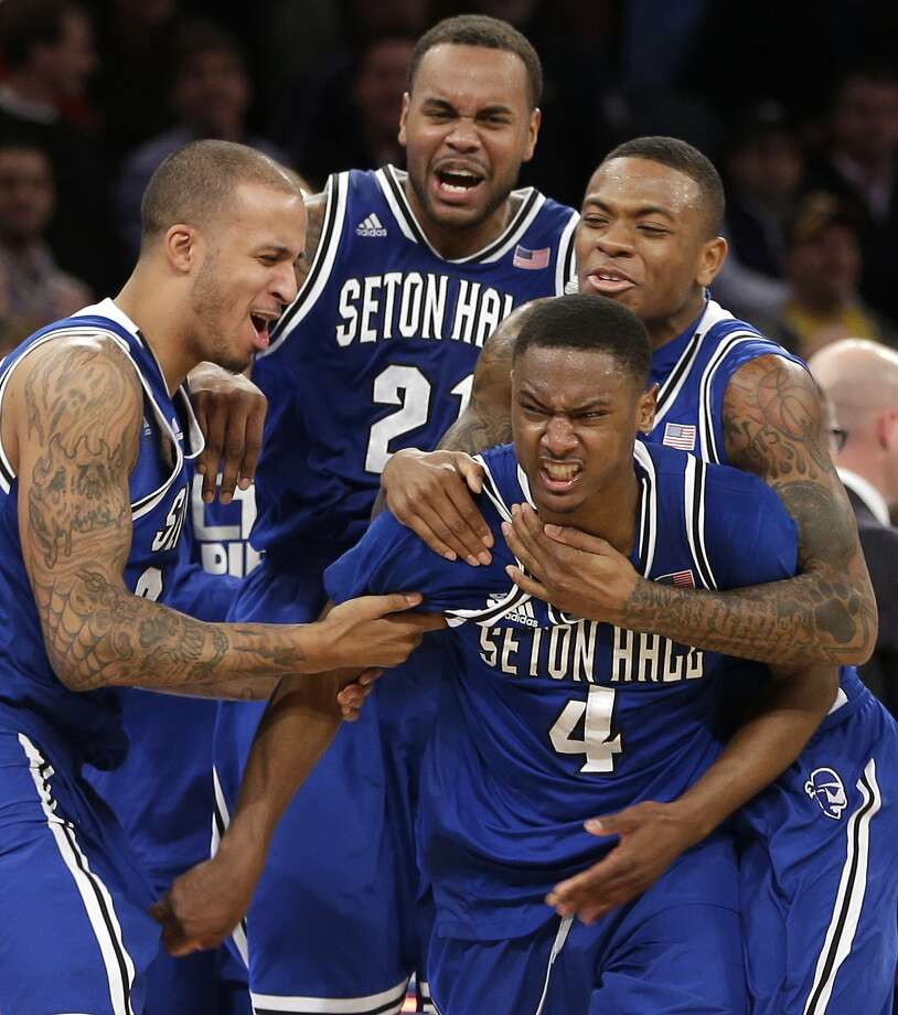 Seton Hall's Sterling Gibbs is mobbed by his teammates after he hit the winning shot against Villanova. Photo: Seth Wenig, Associated Press