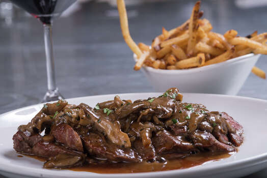 The grilled beef flatiron steak from Cured at the Pearl. Photo: For The San Antonio Express-News