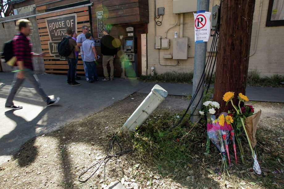 Flowers placed against a utility pole near the scene where 2 people were killed and 23 others injured when a motorist fleeing police drove his car through a crowd of pedestrians near Mohawks during SXSW Music Festival in Austin, Texas, on Thursday, March 13, 2014.  The driver, identified as Rashad Charjuan Owens, 21, of Killeen, was taken into custody will face capital murder charges. Photo: Rodolfo Gonzalez, Associated Press / Austin American-Statesman