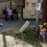 Flowers placed against a utility pole near the scene where 2 people were killed and 23 others injured when a motorist fleeing police drove his car through a crowd of pedestrians near Mohawks during SXSW Music Festival in Austin, Texas, on Thursday, March 13, 2014.  The driver, identified as Rashad Charjuan Owens, 21, of Killeen, was taken into custody will face capital murder charges.