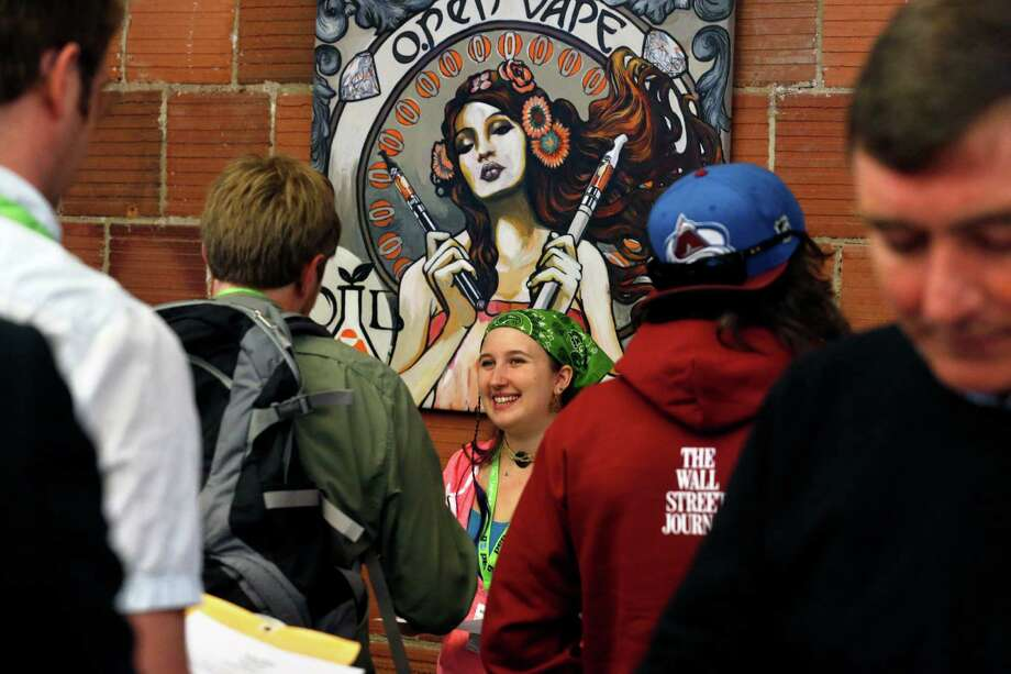 Grace Sisti of Colorado Harvest and Evergreen Apothecary meets job-seekers. Work descriptions included web designer, sales reps and bud tenders. Photo: Brennan Linsley, STF / AP