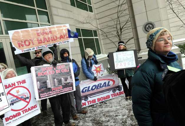 Sandy Steubing of Albany speaks as protestors hold a press conference outside the state DEC building to request full environmental impact analysis before expansion of oil facilities at Port of Albany on Thursday, March 13, 2014, on Broadway in Albany, N.Y. (Michael P. Farrell/Times Union)
