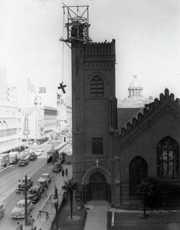 Old cross coming down at Christ Church Cathedral, November 1951. Looking north on Fannin. Photo: Houston Chronicle / Houston Chronicle