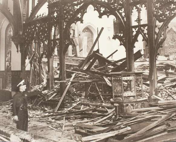 A Roman Catholic fireman saved the nave of the church by training his fire hose on the rood screen, thus forming a wall of water between the chancel and the nave, March 13, 2014 in Houston on display at Treebeards. Photo: Eric Kayne, For The Chronicle / Eric Kayne