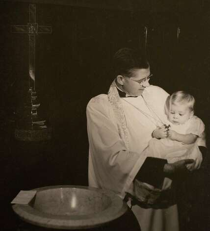 Dean (later Bishop) Richardson, baptizing baby McFarland, circa 1950's, March 13, 2014 in Houston on display at Treebeards. Photo: Eric Kayne, For The Chronicle / Eric Kayne