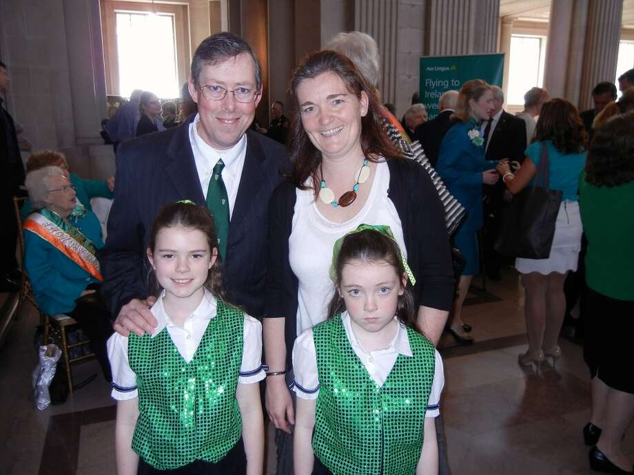Irish-Herald Publisher Sean Canniffe and his wife, Olivia Canniffe, with their daughters Maeve (left) and Mary Rose at City Hall. Photo: Catherine Bigelow