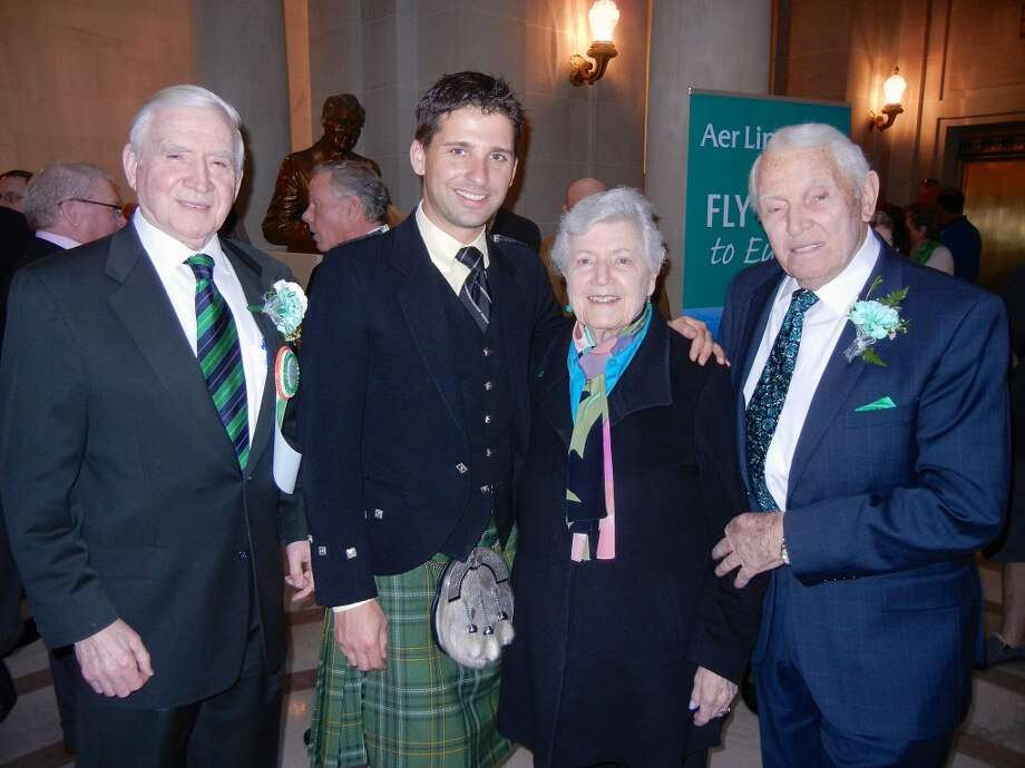 S.F. United Irish Societies President Diarmuid Philpott (left) with S.F. Irish Pipers Band Major Michael Leboeuf and Phyllis and John Moylan at City Hall. Photo: Catherine Bigelow