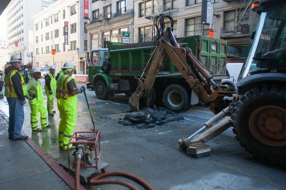 Crews work on a a water line break near the Stockton Street tunnel on Thursday afternoon. Photo: Douglas Zimmerman, SF Gate