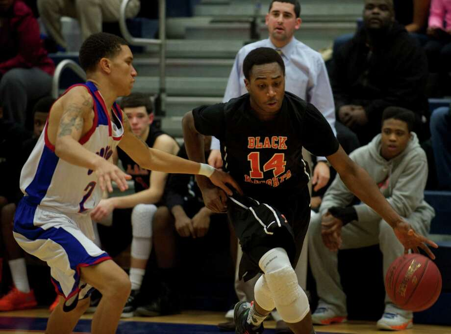 Stamford's Kenny Wright (14) drives abound Crosby's Jarron Chapman (2) during the boys Class LL state basketball playoffs between Stamford High School and Crosby High School played at Crosby, in Waterbury, Conn, on Thursday, March 13, 2014. Photo: H John Voorhees III / The News-Times Freelance