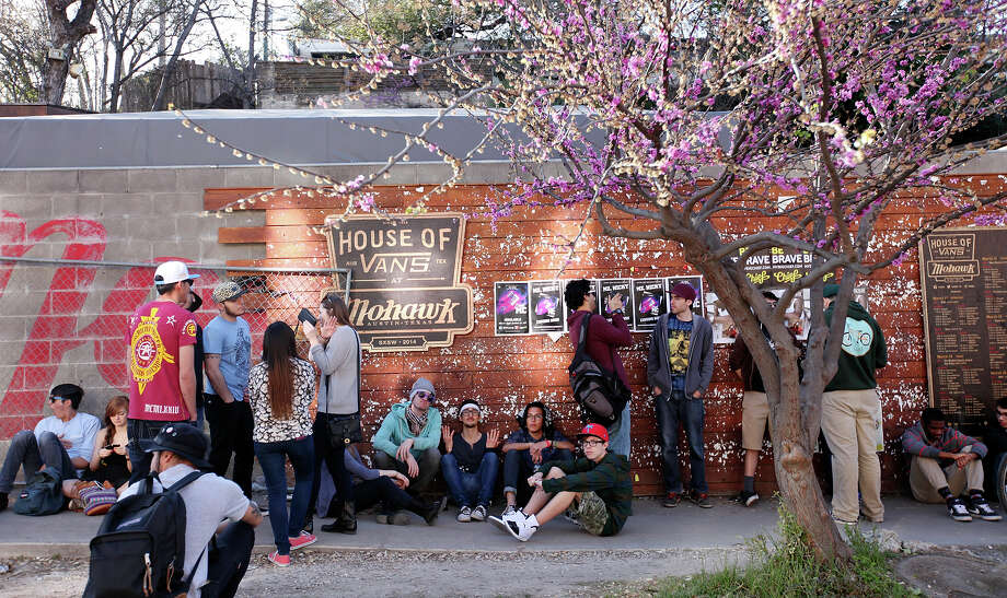 People line up for shows outside the Mohawk Thursday March 13, 2014 in Austin, Tx., near the scene where at least 2 people were killed by a motorist fleeing police. Photo: Edward A. Ornelas, San Antonio Express-News / © 2014 San Antonio Express-News