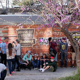 People line up for shows outside the Mohawk Thursday March 13, 2014 in Austin, Tx., near the scene where at least 2 people were killed by a motorist fleeing police.