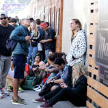 People line up for shows outside the Mohawk Thursday March 13, 2014 in Austin, Tx., near the scene where 2 people were killed and 23 others injured early Thursday morning by a motorist fleeing police.