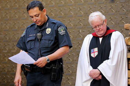 Austin Police Chief Art Acevedo (left) and St. David's Episcopal Church assistant priest Bob Gibble attend a vigil at St. David's Episcopal Church, Thursday March 13, 2014 in Austin, Tx., for the victims of the South by Southwest crash. Photo: Edward A. Ornelas, San Antonio Express-News / © 2014 San Antonio Express-News