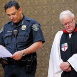 Austin Police Chief Art Acevedo (left) and St. David's Episcopal Church assistant priest Bob Gibble attend a vigil at St. David's Episcopal Church, Thursday March 13, 2014 in Austin, Tx., for the victims of the South by Southwest crash.