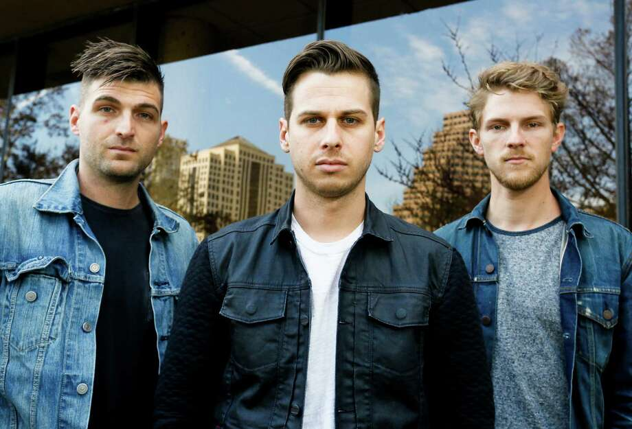 Foster The People's Cubbie Fink, Mark Foster, and Mark Pontius, from left, pose for a photograph during the SXSW Music Festival on Thursday, March 13, 2014, in Austin, Texas. (Photo by Jack Plunkett/Invision/AP) Photo: Jack Plunkett, Associated Press / Invision
