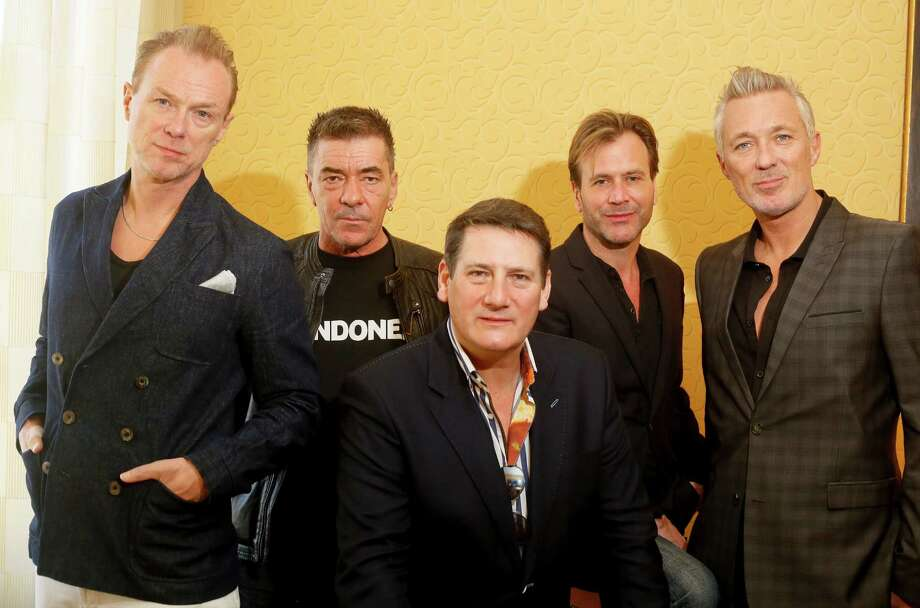 Spandau Ballet members, from left, Gary Kemp, John Keeble, Tony Hadley, Steve Norman and Martin Kemp pose for a photograph during the SXSW Music Festival on Thursday, March 13, 2014, in Austin, Texas. (Photo by Jack Plunkett/Invision/AP) Photo: Jack Plunkett, Associated Press / Invision