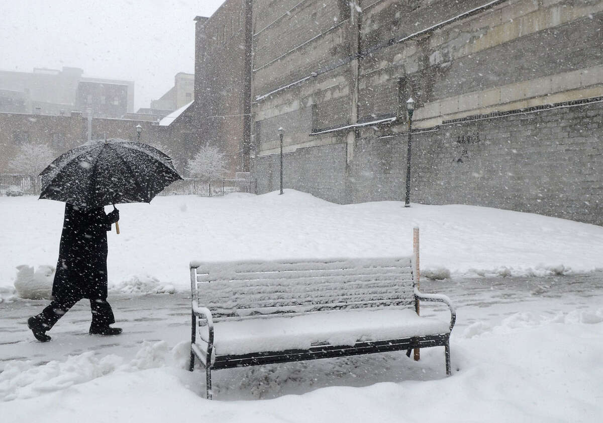 A pedestrian makes his way through the blizzard Wednesday in Syracuse, N.Y. Bitter cold returned to upstate New York on Thursday. Some places got more than a foot of snow.