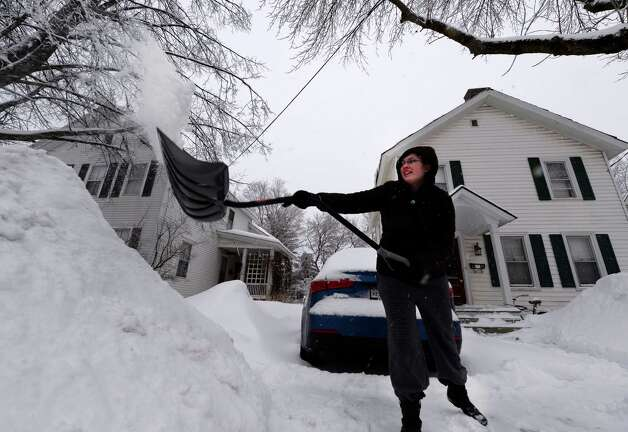 Alicia Citriniti removes snow from her driveway Thursday morning, March 13, 2014, on Morgan St.  in Glens Falls, N.Y.  Glens Falls received almost a foot of snow.       (Skip Dickstein / Times Union) Photo: SKIP DICKSTEIN / 00026147A