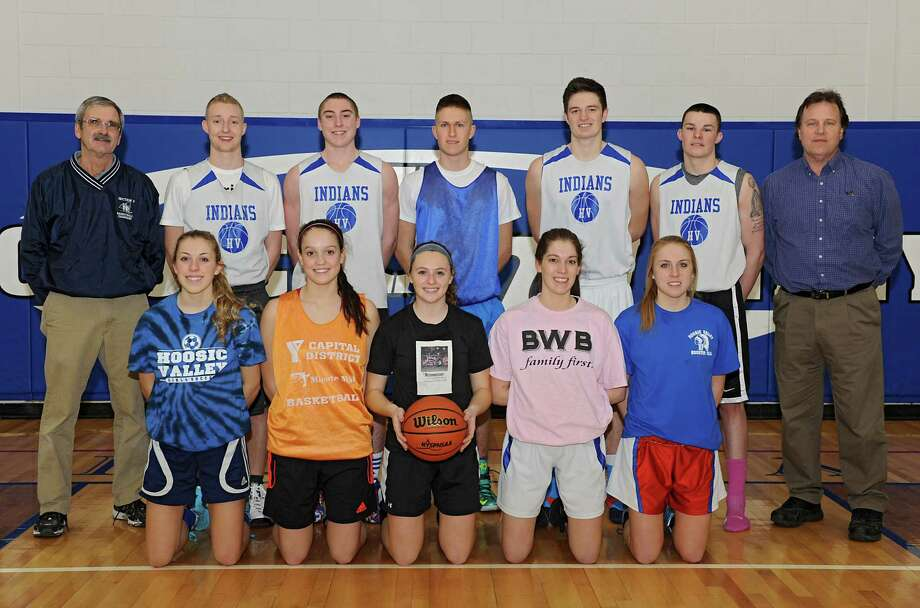 The Hoosic Valley boys and girls starting basketball players with their coaches, top row (l. to r) Dan Calhoun (boys coach,) JT Sawyer, Conway Gillespie, Mack Anderson, John Rooney, Mike Pierre and Walter Dorman (girls coach), bottom row (l. to r) Lauren Madigan, Alyssa Paul, Samantha Carlo, Tracy Anderson and Laura McGreevy on Thursday, March 13, 2014 in Schaghticoke, N.Y. The teams are preparing for the state semifinals. (Lori Van Buren / Times Union) Photo: Lori Van Buren / 00026135A