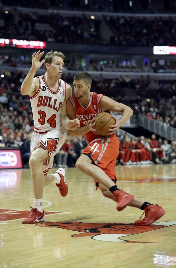 March 13: Bulls 111, Rockets 87  Rockets forward Chandler Parsons, right, drives against Bulls guard Mike Dunleavy. Photo: Nam Y. Huh, Associated Press