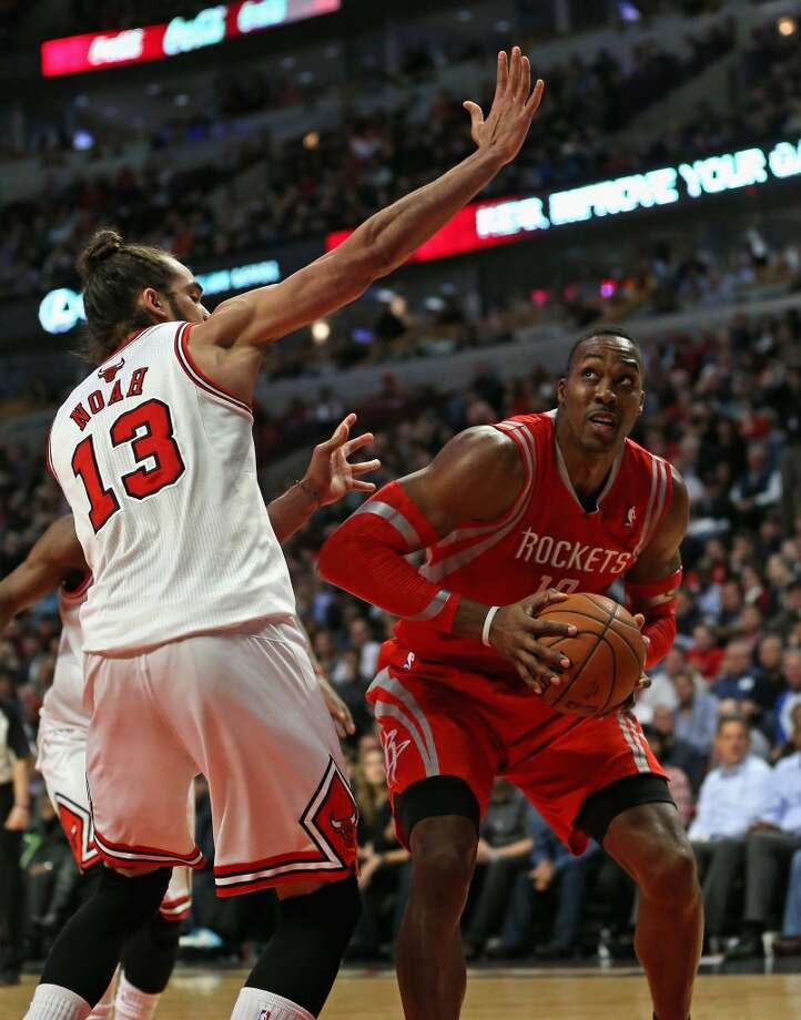 Dwight Howard moves against Joakim Noah. Photo: Jonathan Daniel, Getty Images